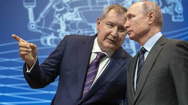 Рогозин «прикрывается» газеткой?